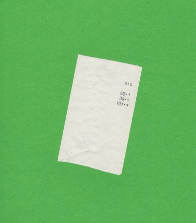 finger proof: bill or receipt isolated over green background