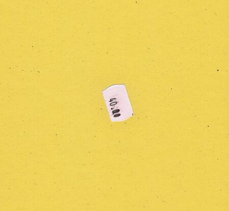 paperboard: 40.00 price tag label over yellow paperboard background