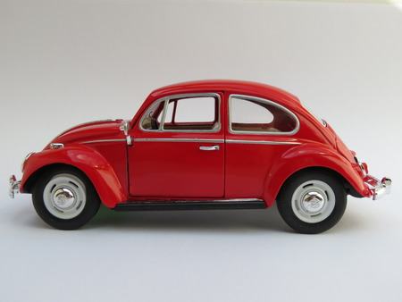 WOLFSBURG, GERMANY - CIRCA APRIL 2015: Miniature Representation of Volkswagen Type-1 aka Classical Beetle from 1967, produced as a childrens toy in China, circa 2008 Editöryel