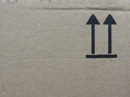 this side up: This side up sign on a cardboard box Stock Photo