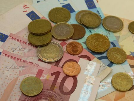 legal tender: Euro EUR banknotes and coins money useful as a background or money concept