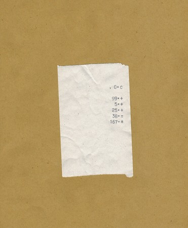 finger proof: bill or receipt isolated over light brown background