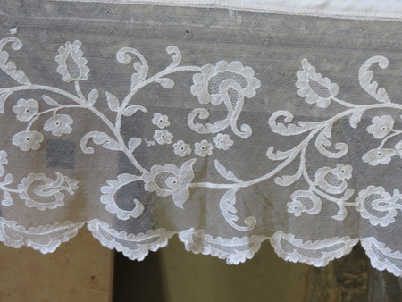 a white luxurious floral lace ribbon band photo