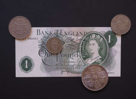 withdrawn: Pound banknote from the 70s and coins currency of the United Kingdom now withdrawn