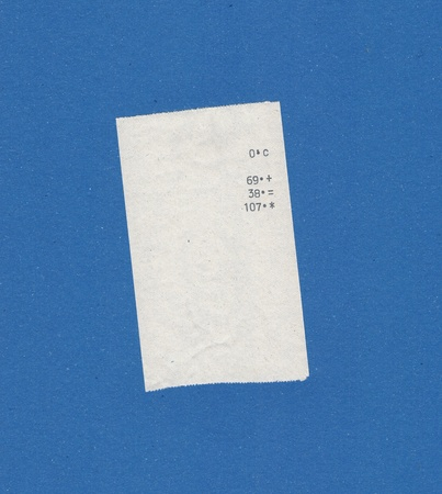 finger proof: bill or receipt isolated over blue background Stock Photo