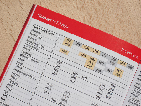 listed: LONDON, UK - CIRCA AUGUST 2015: Northbound trains from London listed on a paper timetable