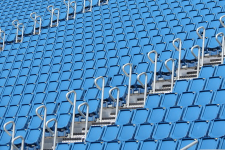 yellow tigers: Empty audience blue plastic seats at the stadium Stock Photo