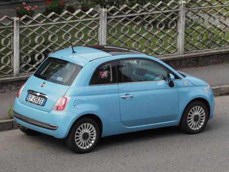 fiat: MILAN, ITALY - CIRCA AUGUST 2015: light blue new Fiat 500 2010s version parked on a street