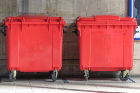 garbage bin: Red waste containers aka Litter bin garbage bin trash bin or waste bin