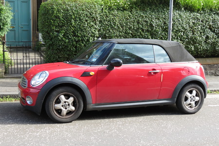 produced: EDINBURGH, SCOTLAND, UK - CIRCA AUGUST 2015: red Mini Cooper car new model, produced from 2013 onwards with black roof Editorial
