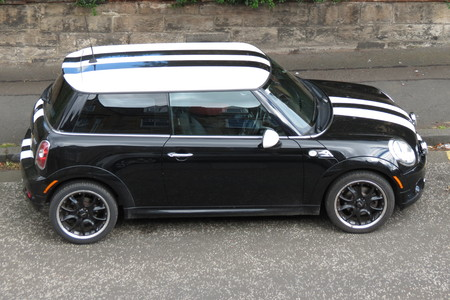 onwards: EDINBURGH, SCOTLAND, UK - CIRCA AUGUST 2015: black Mini Cooper car new model, produced from 2013 onwards with white roof