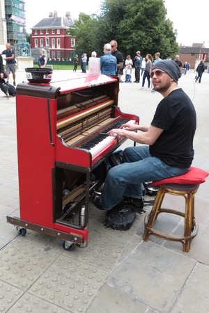 boogie: YORK, UK - CIRCA AUGUST 2015: Karl Mullen street piano player performing as usual on the street of York