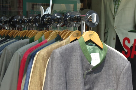 strip shirt: GRAZ, AUSTRIA - CIRCA JULY 2015: Row of men suit jackets on hangers