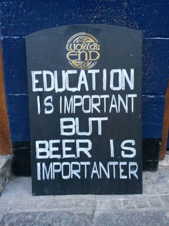 adjective: EDINBURGH, SCOTLAND, UK - CIRCA AUGUST 2015: Education is important but beer is importanter, funny pun wooden sign label before a pub