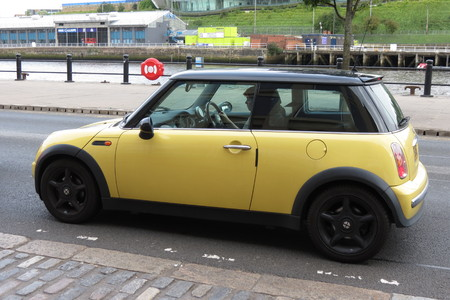 onwards: NEWCASTLE, UK - CIRCA AUGUST 2015: yellow Mini Cooper car new model, produced from 2013 onwards