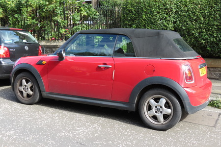 onwards: EDINBURGH, SCOTLAND, UK - CIRCA AUGUST 2015: red Mini Cooper car (new model, produced from 2013 onwards) with black roof Editorial