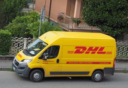 operates: MILAN, ITALY - CIRCA AUGUST 2015: DHL van parked on a street. DHL is a world wide courier company that operates in 220 countries with over 285,000 employees