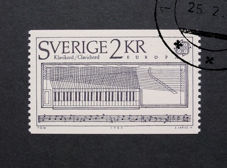 meter box: STOCKHOLM, SWEDEN - MAY 23, 2015: A stamp printed by Sweden shows a clavichord stringed keyboard music instrument Editorial