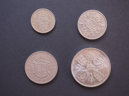 withdrawn: LONDON, UK - CIRCA DECEMBER 2014: one shilling, two shillings, half-crown, crown Predecimal British Pound coins, withdrawn on Decimal Day, i.e. 15 February 1971