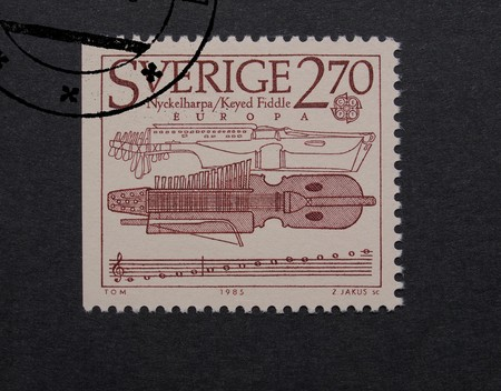 fiddle: STOCKHOLM, SWEDEN - MAY 23, 2015: A stamp printed by Sweden shows a keyed fiddle music instrument