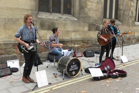 amplified: YORK, UK - CIRCA AUGUST 2015: rock band King No-one performing on a street of the city centre Editorial