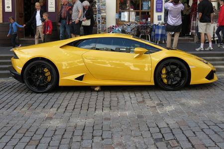 gallardo: EDINBURGH, SCOTLAND, UK - CIRCA AUGUST 2015: yellow Lamborghini Gallardo Willimantic parked on a street of the city centre