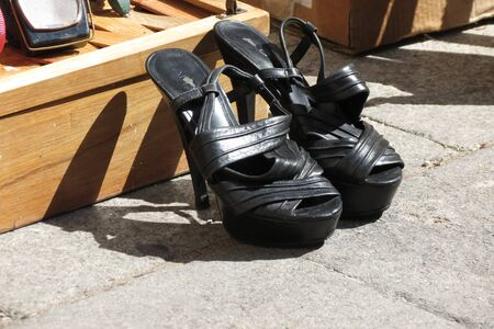 wearing sandals: LISBON, PORTUGAL - CIRCA JUNE 2015: a pair of black high heel shoes for sale at the market
