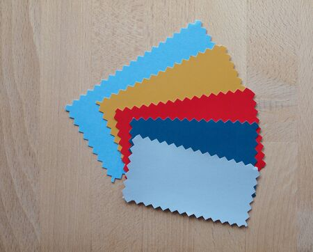 zig zag: Blue red yellow paper swatch with zig zag border cut with pinking shears