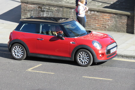 produced: YORK, UK - CIRCA AUGUST 2015: red Mini Cooper car (new model, produced from 2013 onwards) with black roof