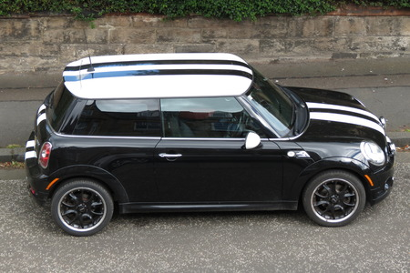 produced: EDINBURGH, SCOTLAND, UK - CIRCA AUGUST 2015: black Mini Cooper car (new model, produced from 2013 onwards) with white roof