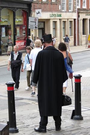 the 19th century: YORK, UK - CIRCA AUGUST 2015: 19th century gentleman in the street Editorial