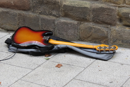amplified: YORK, UK - CIRCA AUGUST 2015: Electric bass guitar lying on the pavement