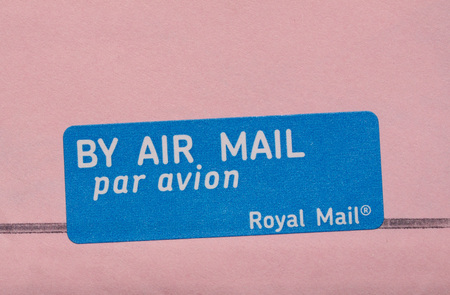 par avion: LONDON, UK - CIRCA MAY 2015: by air mail - par avion tag by the Royal Mail international mail tag written in English and French Editorial