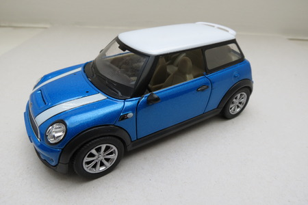 cooper: OXFORD, UK - CIRCA OCTOBER 2015: minuature representation of a light blue Mini Cooper car (2013 version) with white roof produced as a childrens toy in China, circa 2014