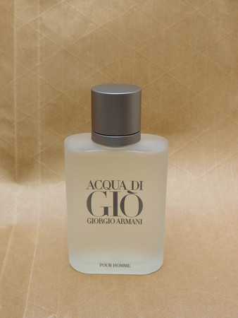 eau: MILAN, ITALY - CIRCA MARCH 2014: Giorgio Armani, Acqua di Gio fragrance for men is one of the evergreen bestselling perfumes worldwide