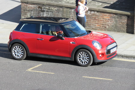 onwards: YORK, UK - CIRCA AUGUST 2015: red Mini Cooper car new model, produced from 2013 onwards with black roof