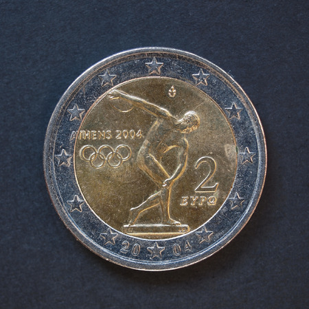 commemorative: Commemorative 2 Euro coin (Greece 2004 - Oympic games in Athens) over black background