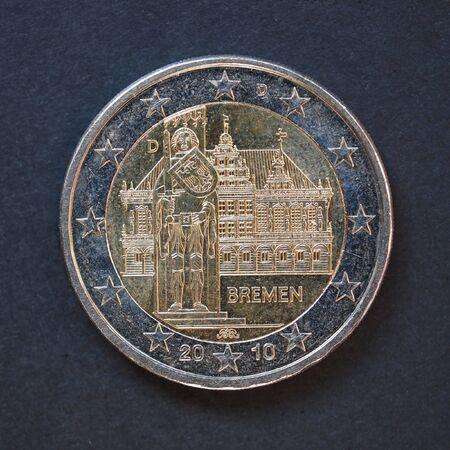 Commemorative 2 Euro coin (Germany 2010 - Bremen) over black background