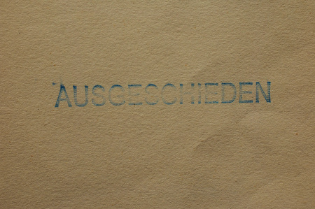 withdrawn: Ausgeschieden (i.e. Withdrawn) stamped on a book cover