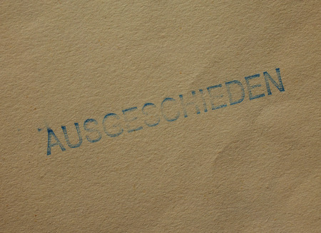 stamped: Ausgeschieden i.e. Withdrawn stamped on a book cover Stock Photo