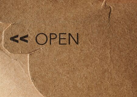 stamped: Open stamped over brown paper sheet background Stock Photo