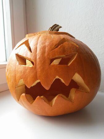 haunting: Big round orange pumpkin cut for Halloween lantern
