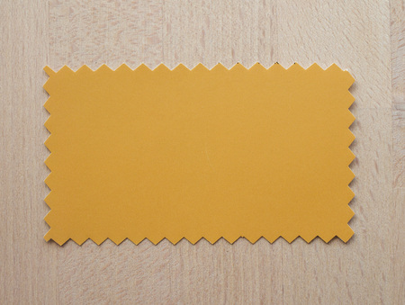 zig zag: Yellow paper swatch with zig zag border cut with pinking shears
