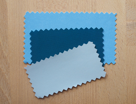 zig zag: Blue and grey paper swatch with zig zag border cut with pinking shears