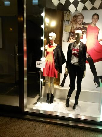 exhibiting: PADUA, ITALY - CIRCA NOVEMBER 2014: stylish fashion shop in the city centre displaying high couture clothes, for which Italy is famous worldwide