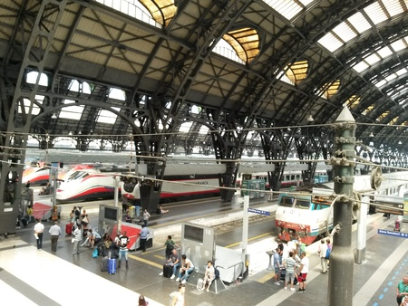 railway: MILAN, ITALY - CIRCA JULY 2014: Milano Centrale, Main railway station in Milan with Frecciarossa high-speed trains and passengers