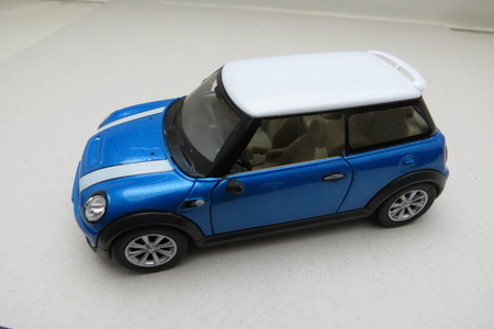 minors: OXFORD, UK - CIRCA OCTOBER 2015: miniature representation of a light blue Mini Cooper car (2013 version) with white roof produced as a childrens toy in China, circa 2014