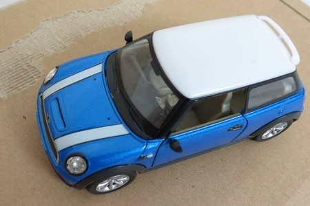 produced: OXFORD, UK - CIRCA OCTOBER 2015: miniature representation of a light blue Mini Cooper car (2013 version) with white roof produced as a childrens toy in China, circa 2014