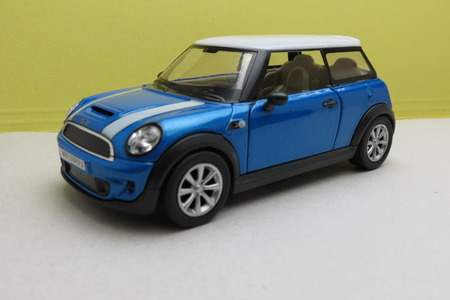 minors: OXFORD, UK - CIRCA OCTOBER 2015: miniature representation of a light blue Mini Cooper car 2013 version with white roof produced as a childrens toy in China, circa 2014