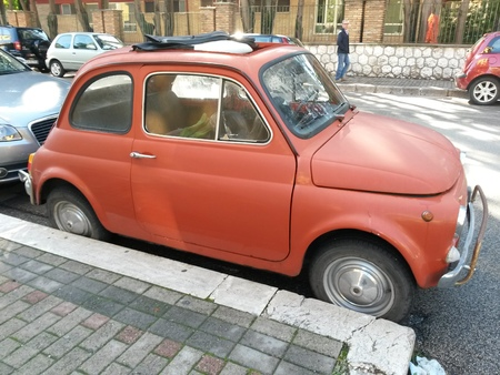 fiat: ROME, ITALY - CIRCA OCTOBER 2015: red FIAT 500 car parked in a street of the city centre Editorial